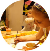 Children painting during an art class at Ocarina School.