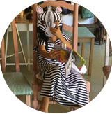 Child dressed like a zebra during the Holiday artistic & cultural Camp at Ocarina School.