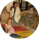 Three children playing during a theatre class at Ocarina School.