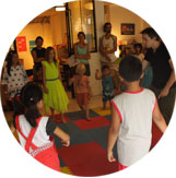 Group of children playing during a theatre class at Ocarina School